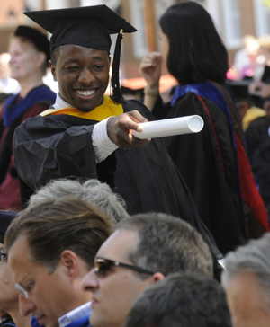 A happy RMC graduate at commencement