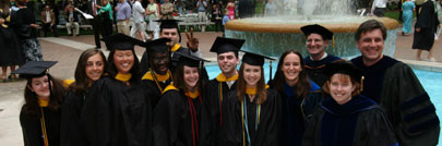 students in fountain at graduation