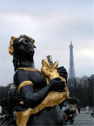 statue with Eiffel tower in background