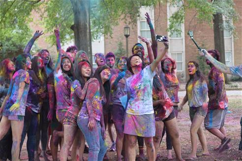 Students Covered in Colored Powder for Holi Fest
