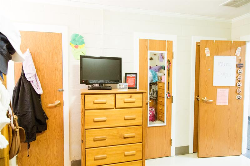 View of the room facing the bathroom door and closet while standing in the middle of the residential room in Irby Residence Hall