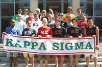 Students Standing Behind Kappa Sigma Banner