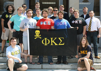 Students Standing Behind Phi Kappa Sigma Banner
