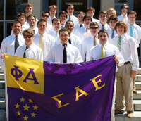 Students Standing Behind Sigma Alpha Epsilon Banner