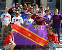 Students Standing Behind Sigma Phi Epsilon Banner