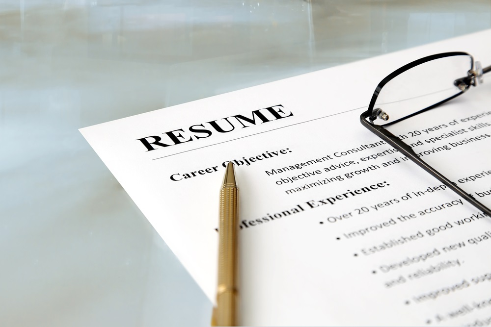 Example Resume with a Pen and Glasses Lying on Top