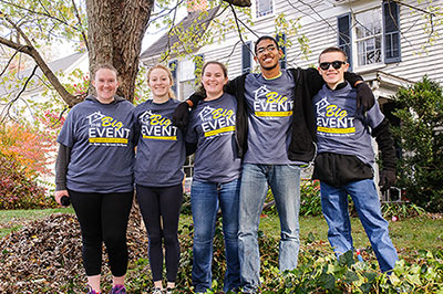 Five Serve students wearing The Big Event shirts and linking arms.
