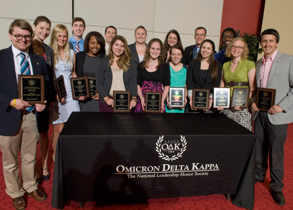 Omicron Delta Kappa Students Holding Plaques