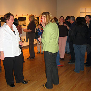 People viewing an exhibit at the Flippo Gallery